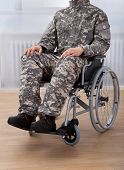 Patriotic Soldier Sitting On Wheel Chair