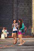 Young Women Walking in Banos, Ecuador