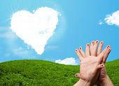 Happy cheerful smiley fingers looking at heart shaped cloud