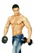 Portrait of a handsome muscular bodybuilder posing with dumbbell. Isolated over white background.