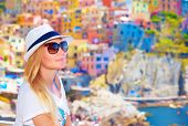 Traveler girl enjoying colorful cityscape, spending summer vacation in Europe, Italy, beautiful pain