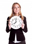 Portrait of happy smiling business woman holding in hands big clock isolated on white background, regular schedule, success concept