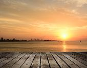 Famous sunset in Tamsui (Danshui), Taiwan, Asia. Focus on wooden floor.