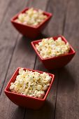 picture of popcorn  - Three red bowls of freshly prepared salted popcorn  - JPG
