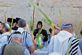 JERUSALEM, ISRAEL - SEPTEMBER 20, 2013: Morning Sukkot. Many religious Jews in traditional robes tallit gathered for prayer. The Western Wall of the Temple in Jerusalem