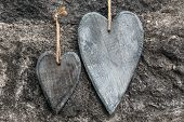 Two Wooden Hearts In Front Of Stony Background