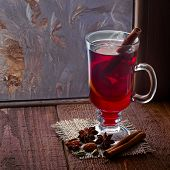 Glass of mulled wine on old wooden table