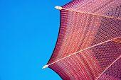 Thailand pattern silk umbrella and sky blue art artist handicraft beach.