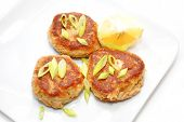 picture of crab-cakes  - Fish Cakes Served with Lemon and Scallions - JPG