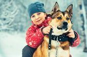 Girl Child and Dog hugging and playing Outdoor Lifestyle
