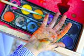 stock photo of arts crafts  - artist children painting watercolor brush self dirty hands - JPG