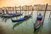Gondolas Moored At Dock In Venice