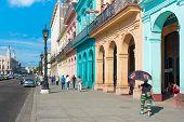 HAVANA, CUBA - JANUARY 8, 2015 : Street scene with colorful buildings on a sunny day in Old Havana