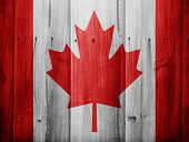 stock photo of wooden fence  - Canada flag painted on the wooden fence - JPG