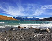 National Park Torres del Paine. Patagonia, Chile. Stormy wind blows high waves on Lake Laguna Azul