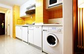 picture of kitchen appliance  - Modern kitchen interior with yellow tile walls - JPG