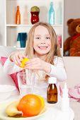 Child Making lemon juice
