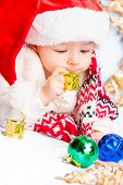 foto of christmas baby  - Beautiful little baby celebrates Christmas - JPG