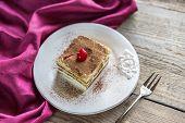 Tiramisu On The Plate On The Wooden Background