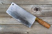 Vintage Butcher Knife On Aged Wood