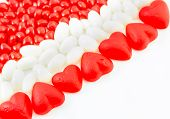 foto of jelly beans  - Valentine candies of June and Cinnamon Hearts and white jelly beans on white background - JPG