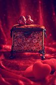 image of casket  - Antique jewellery casket with red hearts for Valentines day - JPG