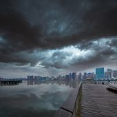 Manhattan New York cloudy dramatic skyline sunset from East River dusk USA