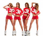 pic of cheerleader  - Beautiful young cheerleader in a red uniform with long hair - JPG