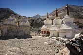 Three stupa and blue sky at Diskit monastery, Ladakh, India - September 2014