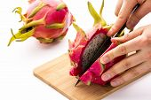 Opening A Ripe Dragonfruit With A Longitudinal Cut