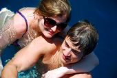 Young Couple Swimming In Sea