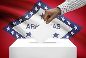 Voting Concept - Ballot Box With Us State Flag On Background - Arkansas