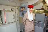 DUBAI - NOV 12: Airbus A380 crew member on November 12, 2014 in Dubai, UAE. Emirates handles major part of passenger traffic and aircraft movements at the airport.
