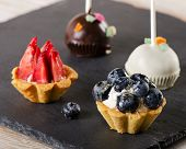 Sweet Chocolate Cake Pops And Berry Tarts