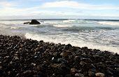 Waves On A Stony Beach