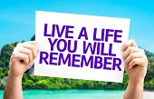 Live a Life You Will Remember card with a beach on background