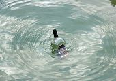 A bottle in the sea, bottle of empty alcohol in perdition