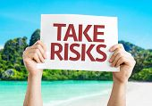 Take Risks card with a beach on background