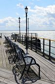 foto of wrought iron  - Wrought iron seats on a Victorian pleasure pier in Southern England - JPG