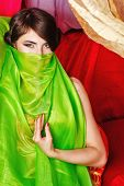 image of harem  - Oriental beauty covers her face with a shawl - JPG