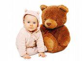 image of baby bear  - Portrait of baby sitting with big teddy bear - JPG