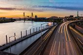 image of portland oregon  - Portland Oregon view of the Steel Bridge with light reflections on the Willamette River - JPG
