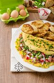 image of french toast  - Omelette with spring vegetables and bacon fresh peas and radish garlic french toast sprinkled with chive and microgreens - JPG