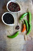 pic of peppercorns  - closeup green chilli peppers and different types of peppercorns - JPG