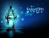 stock photo of kareem  - Beautiful Elegant Ramadan Kareem Lantern or Fanous With Lights in Night in Background Islamic Pattern for the Holy Month Occasion of fasting - JPG