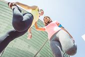 stock photo of stretch  - two runners making stretching before running - JPG