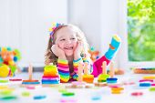 picture of girl toy  - Child playing with wooden toys at preschool - JPG