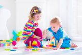 stock photo of kindergarten  - Kids playing with wooden toys - JPG