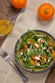 pic of mandarin orange  - Closeup of a plate of arugula salad with mandarins oranges beans sprouts and sliced almonds served with mandarin vinaigrette for healthy lunch - JPG