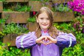 picture of rain  - Outdoor portrait of a cute little girl under the rain - JPG
